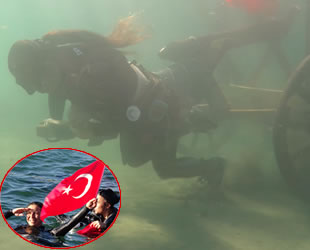 Derya Can, şehit kadınlar için deniz altında 100 kiloluk kağnıyı taşıdı