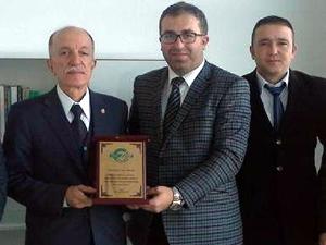 GMO'dan Prof. Dr. Orhan Durgun'a teşekkür plaketi
