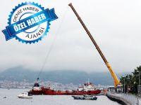 Batık gemiler, körfezin doğusundaki deniz kirliliğinin kaynağı tartışmalarına yeni bir boyut kazandırdı