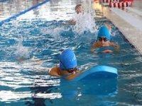 Yüzerek 49 madalya kazandıran özel çocuklar