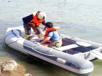 Olta ipine takılan pelikanı itfaiye ekipleri kurtardı
