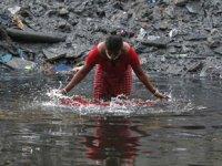 Çin, korona virüsün Hindistan'da aynı su kaynaklarını kullanan hayvanlardan insanlara geçtiğini iddia etti