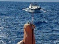 Fethiye'de içerisinde 2 kişi bulunan teknede yangın çıktı
